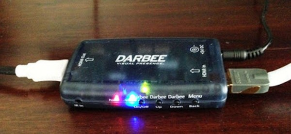 The Darbee Darblet. Note the input side with the wall wart power supply jack on the right, and output end on the left. The blue LED indicates signal incoming.