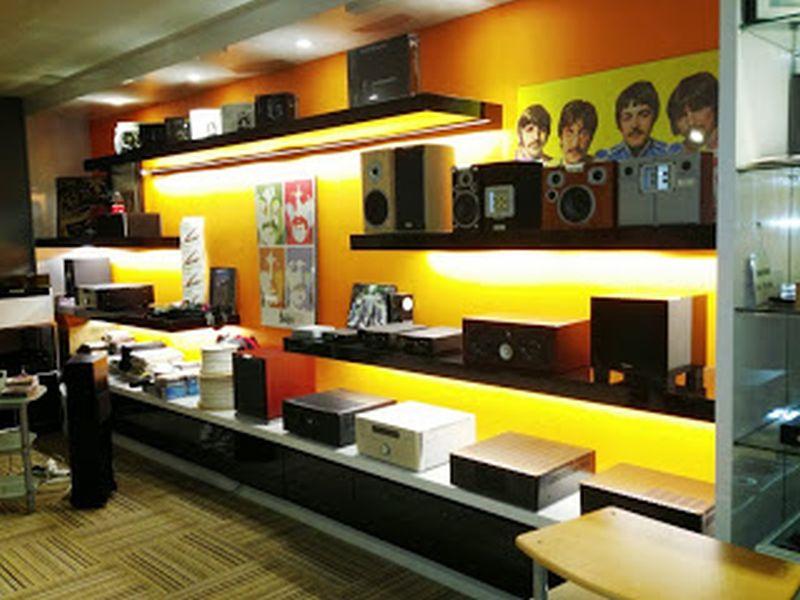 Rows of hi-fi components and Beatles' memorabilia.