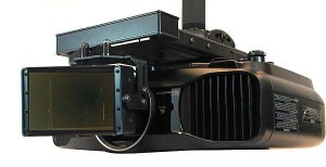The CineVista seen here mounted in front of a projector.  The mounting requires a fair amount of precision work and is permanent ie it does not slide on or off.