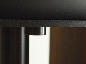 There is a small cast-iron disc which is screwed onto the aluminium top-plate for tuning purposes.