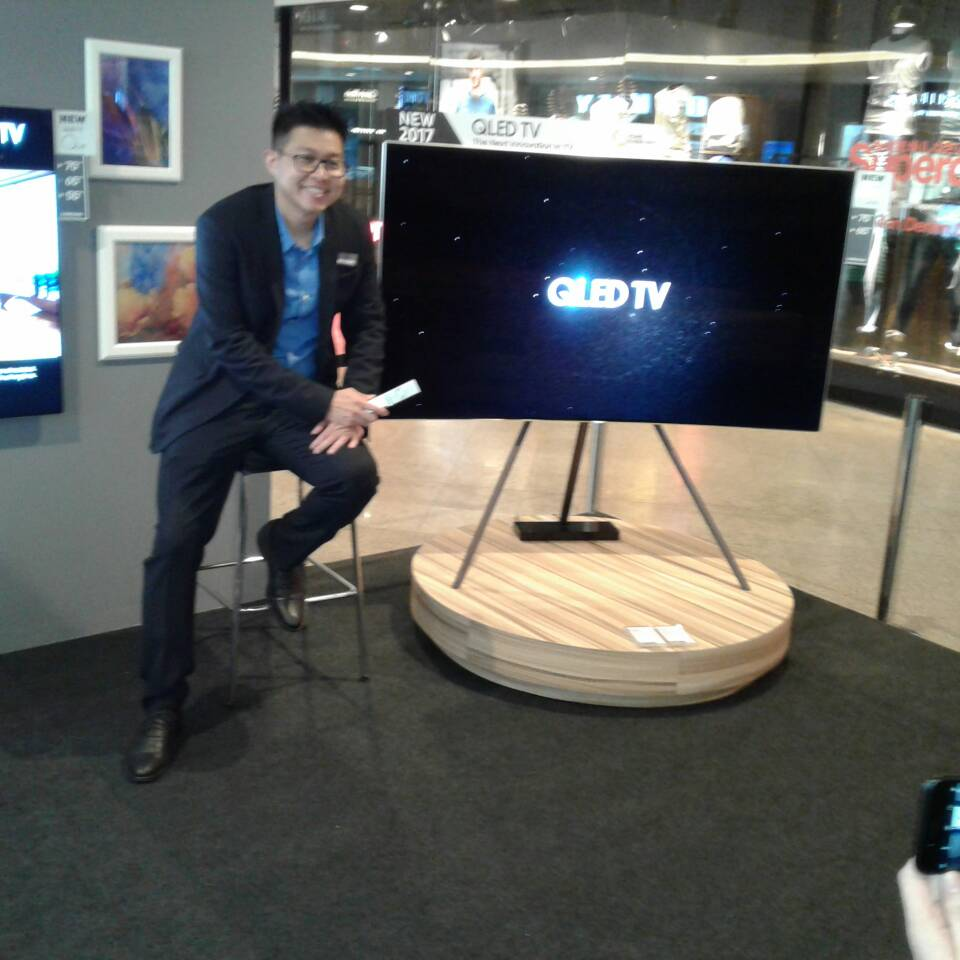 Jason Foo seen here with a QLED UHDTV on one of the options of stand available.  The one seen here is known as the STUDIO mount