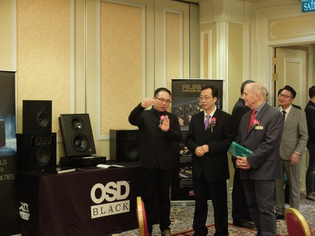 Marcus Yang (1st on the left) explaining to dignitaries about the custom install speakers on display by one of the exhibitors