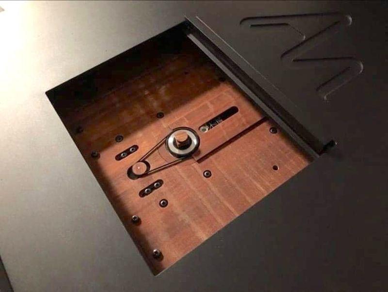 The Audio Note belt-drive CD transport uses Permali wood.